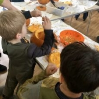 Sticky fun, scooping out the pumpkins